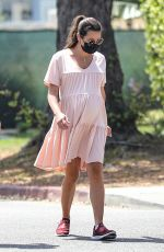 Lea Michele Cradles her baby bump on a walk with her husband and her mom in Santa Monica