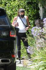 Lea Michele Pictured leaving a friends house holding a small gift bag in Los Angeles