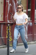 Lily-Rose Depp Steps out in Paris wearing jeans and a white crop top