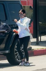 Lucy Hale Makes sure to eat her healthy carrot snack while running errands around Los Angeles