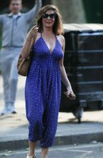 Lucy Horobin Makes busty appearance in plunging blue jumpsuit while leaving Heart Radio in London
