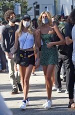 Margaret Qualley, Cara Delevingne and Kaia Gerber at a protest rally in Los Angeles