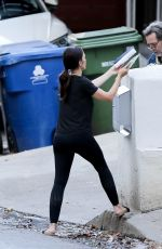 Minka Kelly During a DIY project putting together a mailbox outside her home in Los Angeles