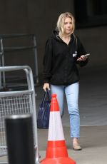 Mollie King Goes makeup free exits BBC radio in denim jeans and casual hoodie in London