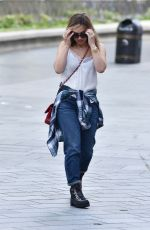 Myleene Klass Arrives Heart radio in satin lace top and denim in London