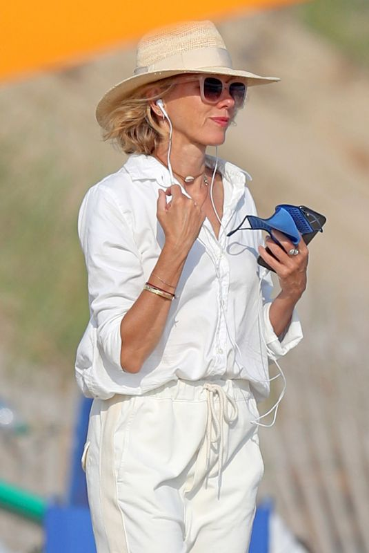 Naomi Watts Hits the beach with a friend with some takeout food in the Hamptons