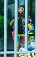 Nicki Minaj Checking her phone while getting picked up by a driver to head to a photo shoot in West Hollywood
