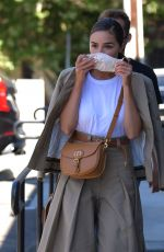 Olivia Culpo In Chic Dior Ensemble as She Visits the Vet with her New Puppy Oliver Sprinkles in LA
