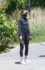 Olivia Palermo Out enjoying a walk with her dog in Brooklyn