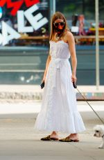 Olivia Palermo Out walking her dog Mr. Butler in NYC