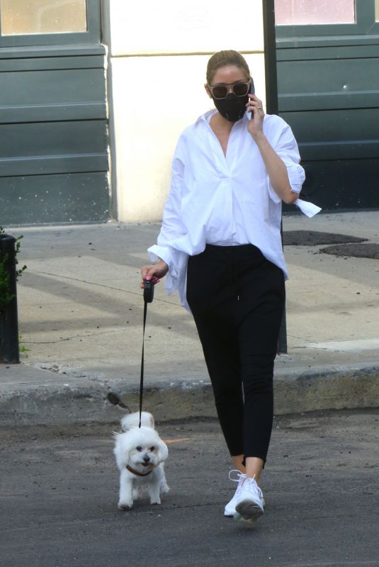 Olivia Palermo With her dog Mr. Butler in NYC