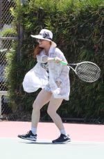 Phoebe Price Gets a tennis lesson in Los Angeles
