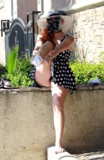 Phoebe Price Getting ready for tennis in a polka dot dress on Tuesday in Los Angeles