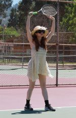 Phoebe Price Hitting tennis balls and cooling off by lifting her dress at the tennis court on Friday in Los Angeles