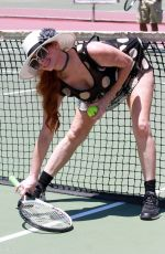 Phoebe Price Posing and playing tennis with a grill on her teeth on Sunday in Los Angeles