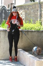 Phoebe Price Posing for photos in a yoga outfit