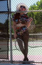 Phoebe Price Seen playing with her tennis coach