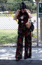Phoebe Price Walking her dog Henry by the park and staying cool in the shade in Los Angeles