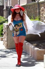 Phoebe Price Wearing a Wonder Woman mini dress and posing with her dog in Los Angeles