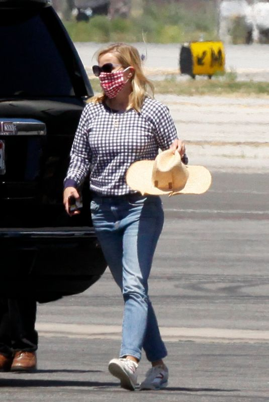 Reese Witherspoon Landing in Los Angeles
