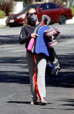 Reese Witherspoon Leaves a morning swim workout carrying a kick board and weights in Los Angeles