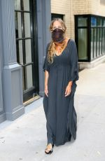 Sarah Jessica Parker Poses outside her shoe store in New York