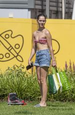 Siannise Fudge and Luke Trotman enjoy a scantily clad massage session in the park - London