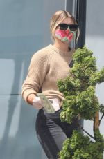 Sofia Richie Wears a floral print mask as she stops for some cash at Chevron gas station in Malibu