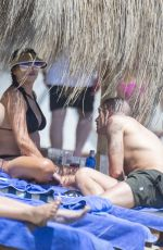 Stacey Giggs Struggles to keep her bikini in place as she splashes in the Marbella