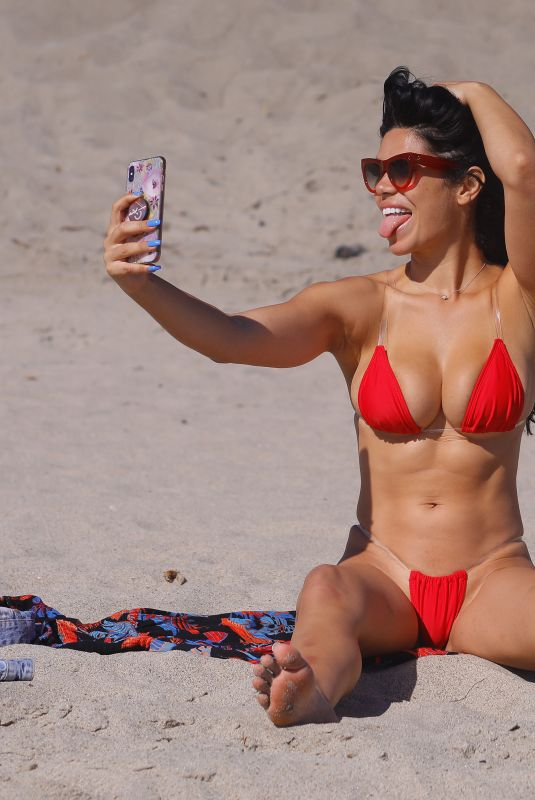 Suelyn Medeiros As she shows off her curves in a bright red bikini in Malibu