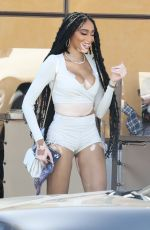 Winnie Harlow Enjoys wine with friends at Il Pastaio restaurant in Beverly Hills