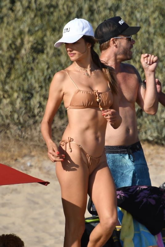 Alessandra Ambrosio In a beige two piece while enjoying drinks on the beach in Malibu