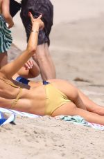 Alessandra Ambrosio Looks stunning in a gold bikini while out soaking up the sun at the beach in Malibu