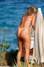 Arabella Chi Wearing her skimpy little bikini out on a shoot in the hot Spanish climes of Ibiza