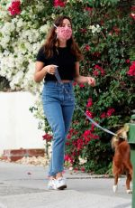 Aubrey Plaza and her fiance Jeff Baena take their two dogs for a walk around their neighborhood in Los Angeles