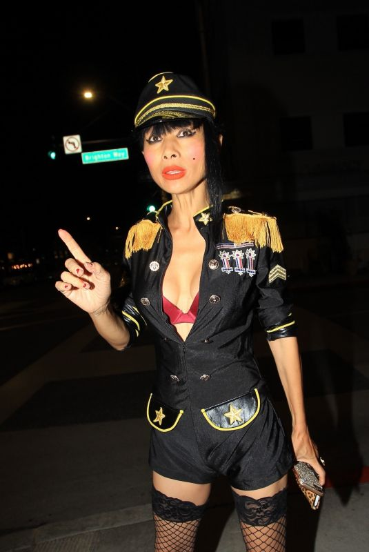 Bai Ling Poses for photos with fans in a custom uniform in Beverly Hills