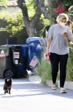 Bebe Rexha Enjoys the fresh air while taking her dog for a walk in Hollywood