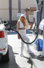 Blac Chyna Sports an all-white look while out pumping her own gas in Calabasas