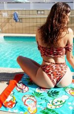 Blanca Blanco Hangs out by her pool wearing a colored one-piece in West Hollyowood