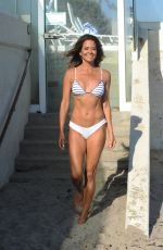 Brooke Burke In tiny white bikini working on her Brooke Burke Body App In Malibu