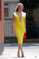 Caprice Bourret In a tight yellow dress out in London