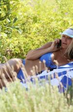Caprice Bourret Sizzles in a tiny blue bikini in Ibiza