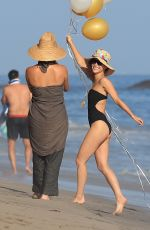 Cara Santana In a black one piece while out celebrating her birthday at the beach with her friends