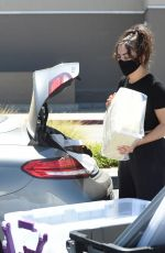 Charli XCX and her friend purchase a few plastic storage containers from Target in Los Angeles