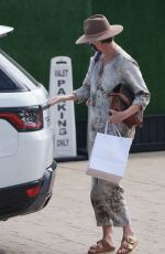 Charlize Theron Keeps a low profile while out for dinner with her daughters and friends at Nobu in Malibu