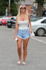 Christine McGuinness Seen in a pair of denim shorts as she runs errands in Hale Cheshire