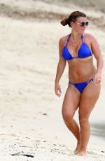 Coleen Rooney In a royal blue bikini while enjoying their Holiday in Barbados