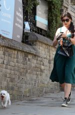 Daisy Lowe Tucking into an ice cream on dog walk in London