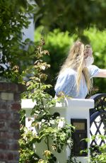 Dakota Fanning Picks up a curbside food delivery in Los Angeles