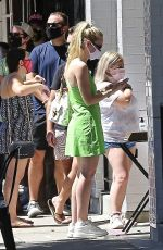 Dakota Fanning Picks up take out in a short dress in LA